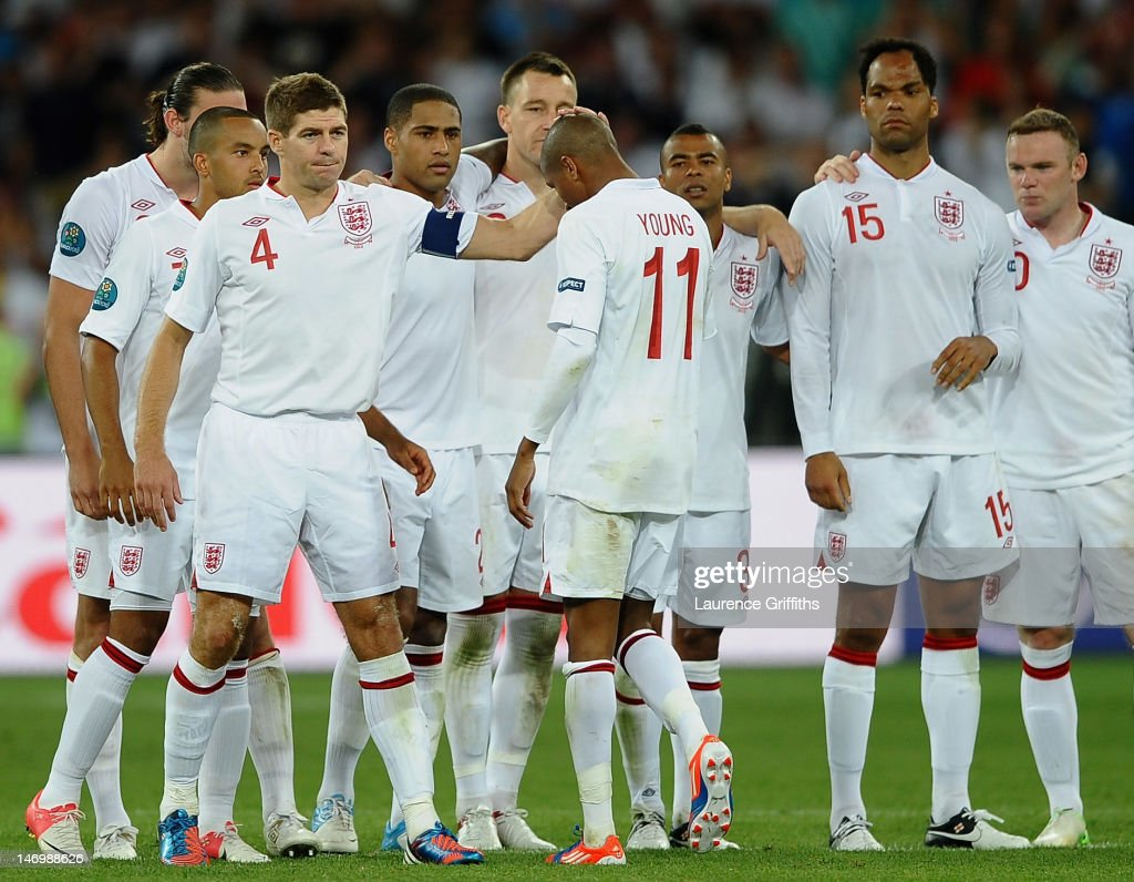 Steven Gerrard of England consoles Ashley Young after missing his penalty during the UEFA EURO 2012 quarter final match between England and Italy at The Olympic Stadium on June 24, 2012 in Kiev, Ukraine.