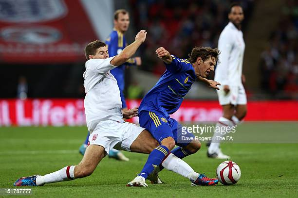 Steven Gerrard of England fouls Denys Garmash of Ukraine to earn his second yellow card during the FIFA 2014 World Cup qualifier group H match...