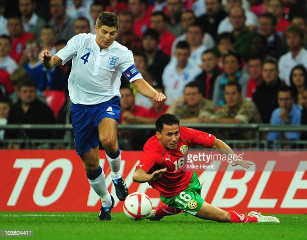 Steven Gerrard of England holds off Zhivko Milanov of Bulgaria during the UEFA EURO 2012 Group G Qualifying match between England and Bulgaria at...
