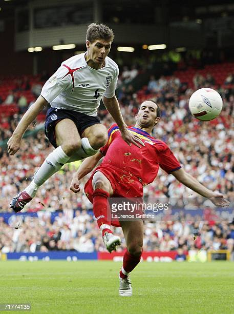 Steven Gerrard of England is challenged by Marcio Vieira of Andorra during the Euro 2008 Qualifying match between England and Andorra at Old Trafford...