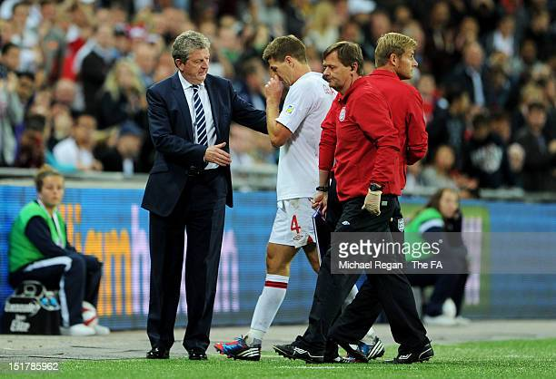 Steven Gerrard of England is consoled by Roy Hodgson the manger of England after being sent off for receiving two yellow cards during the FIFA 2014...