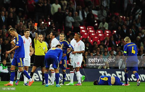 Steven Gerrard of England is sent off by match referee Cuneyt Cakir after a foul on Denys Garmash of Ukraine during the FIFA 2014 World Cup Group H...