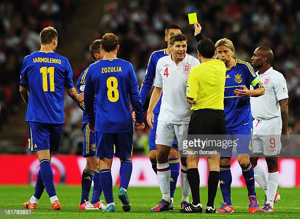 Steven Gerrard of England is shown the yellow card bt referee Cuneyt Cakir during the FIFA 2014 World Cup Group H qualifying match between England...