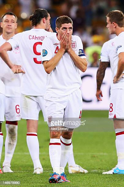 Steven Gerrard of England looks dejected after defeat in the penalty shoot out during the UEFA EURO 2012 quarter final match between England and...