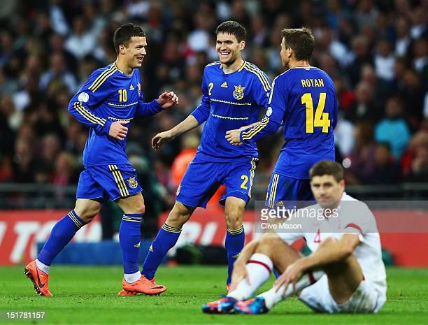 Steven Gerrard of England looks dejected as Yevhen Konoplianka of Ukraine celebrates scoring their first goal with Yevhen Selin and Ruslan Rotan...