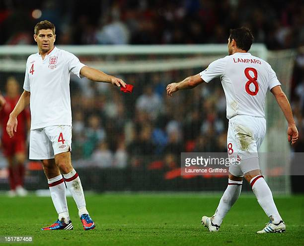 Steven Gerrard of England passes the captains armband to Frank Lampard of England after being sent off by match referee Cuneyt Cakir during the FIFA...