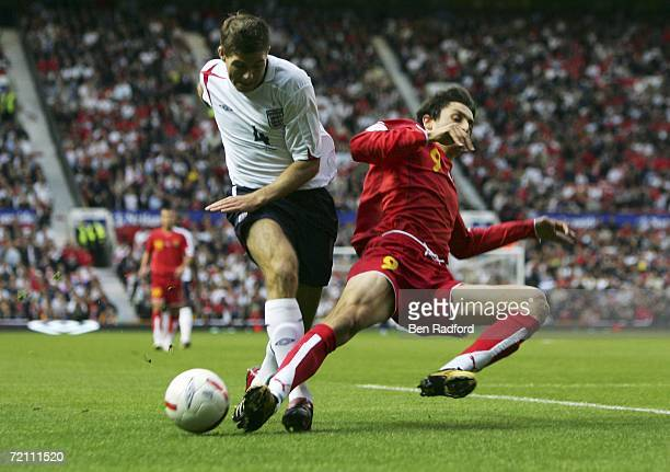 Steven Gerrard of England runs with the ball as Goran Maznov of Macedonia defends during the Euro 2008 Qualifying match between England and Macedonia...