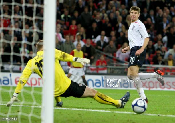 Steven Gerrard of England scores the second goal past goalkeeper Brad Guzan of USA during the international friendly match between England and the...
