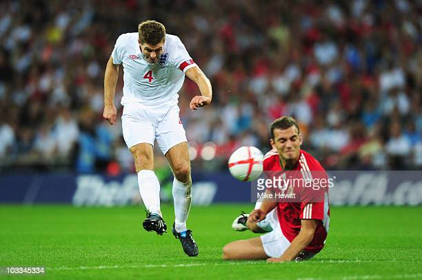 Steven Gerrard of England shoots past Roland Juhasz of Hungary to score the goal that levels the score at 11 during the International Friendly match...