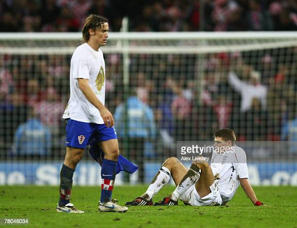 Steven Gerrard of England sits on the floor looking dejected after the Euro 2008 Group E qualifying match between England and Croatia at Wembley...