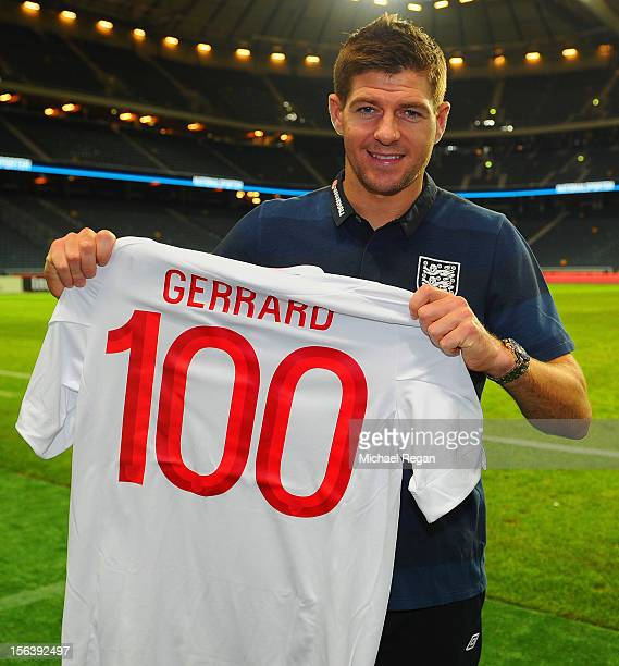 Steven Gerrard of England with a shirt celebrating his 100th international cap after the international friendly match between Sweden and England at...