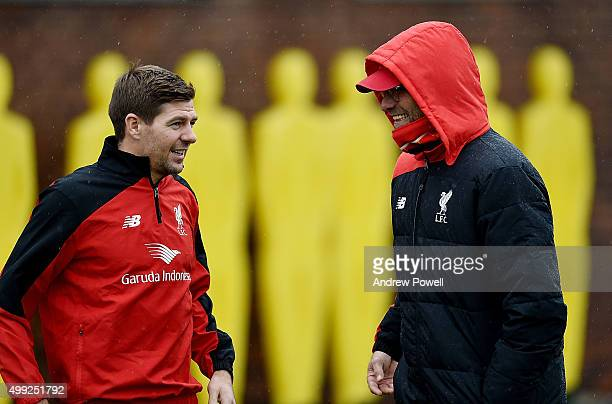 Steven Gerrard of LA Galaxy talks with Jurgen Klopp manager of Liverpool during a training session at Melwood Training Ground on November 30 2015 in...