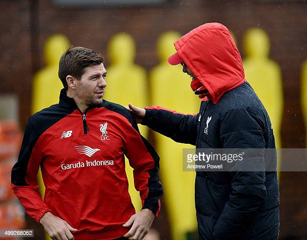 Steven Gerrard of LA Galaxy talks with Jurgen Klopp manager of Liverpool during a training session at Melwood Training Ground on November 30, 2015 in...