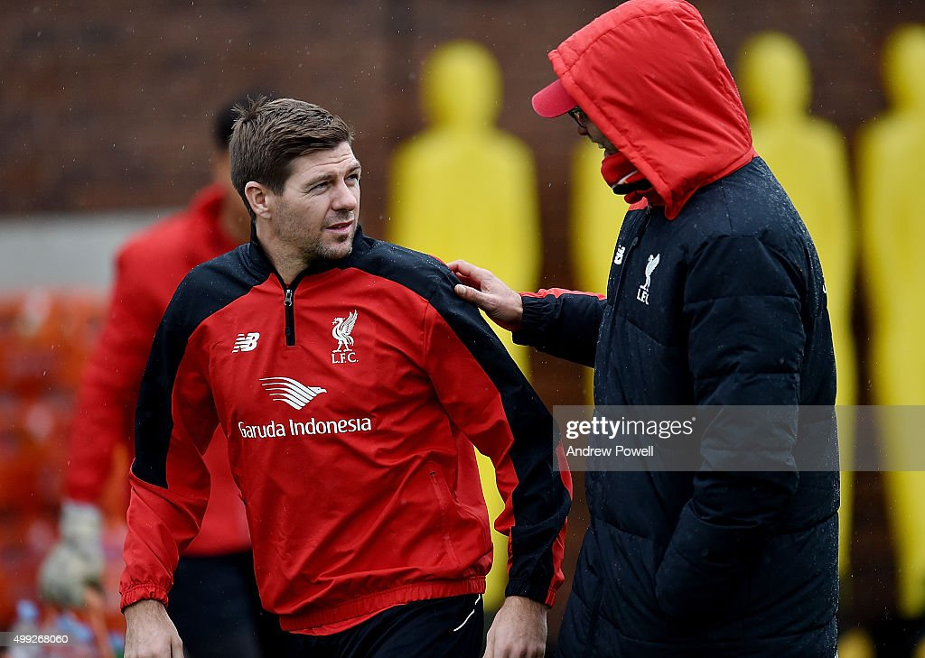 Steven Gerrard of LA Galaxy talks with Jurgen Klopp manager of Liverpool during a training session at Melwood Training Ground on November 30, 2015 in Liverpool, England.