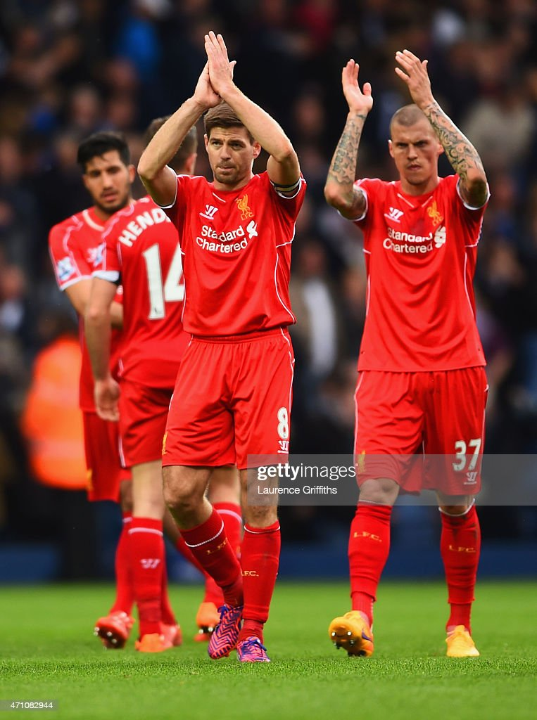 Steven Gerrard of Liverpool and Martin Skrtel of Liverpool applaud the fans after the 0-0 draw in the Barclays Premier League match between West Bromwich Albion and Liverpool at The Hawthorns on April 25, 2015 in West Bromwich, England.