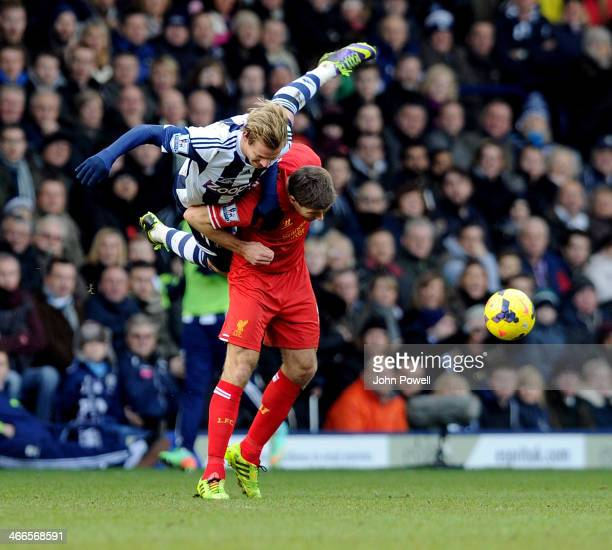 Steven Gerrard of Liverpool and Matejn Vydra of West Bromwich Albion during the Barclays Premier Leauge match between West Bromwich Albion and...