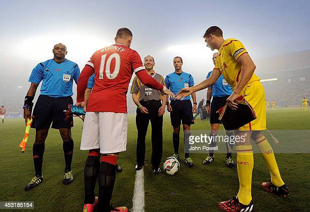 Steven Gerrard of Liverpool and Wanye Rooney at the start of the International Champions Cup 2014 final match between Liverpool FC and Manchester...