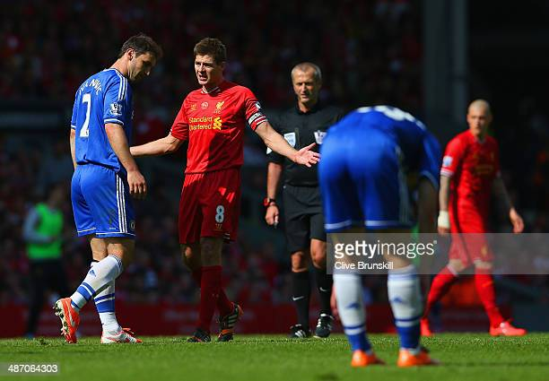 Steven Gerrard of Liverpool appeals as Branislav Ivanovic of Chelsea looks to the ground during the Barclays Premier League match between Liverpool...