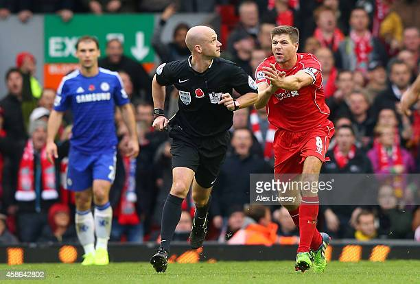 Steven Gerrard of Liverpool appeals to referee Anthony Taylor for a handball during the Barclays Premier League match between Liverpool and Chelsea...