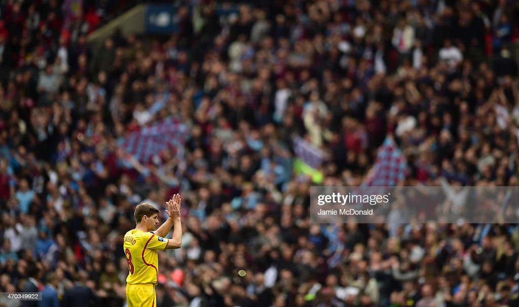 Steven Gerrard of Liverpool applauds the fans after defeat in the FA Cup Semi Final between Aston Villa and Liverpool at Wembley Stadium on April 19, 2015 in London, England.