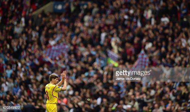 Steven Gerrard of Liverpool applauds the fans after defeat in the FA Cup Semi Final between Aston Villa and Liverpool at Wembley Stadium on April 19...