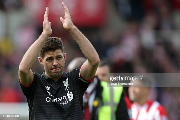 Steven Gerrard of Liverpool applauds the fans after the Barclays Premier League match between Stoke City and Liverpool at Britannia Stadium on May 24...