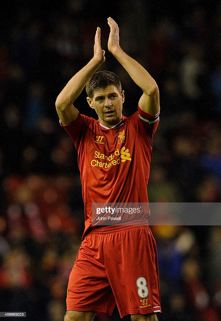 Steven Gerrard of Liverpool applauds the fans at the end of the Barclays Premier League match between Liverpool and Hull City at Anfield on January 1, 2014 in Liverpool, England.