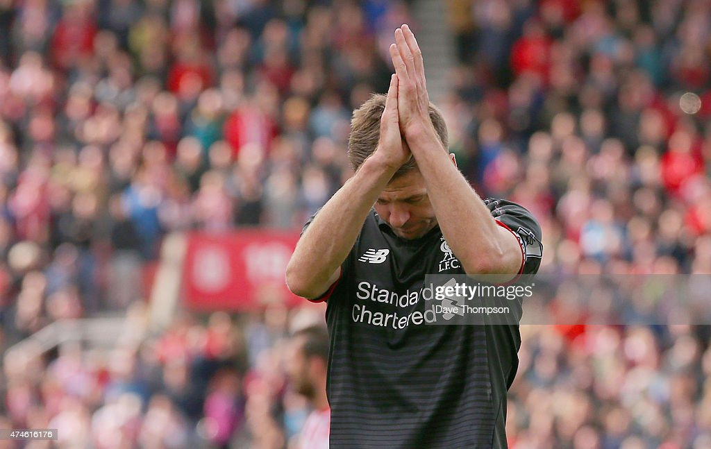 Steven Gerrard of Liverpool applauds the supporters after the Barclays Premier League match between Stoke City and Liverpool at Britannia Stadium on May 24, 2015 in Stoke on Trent, England.