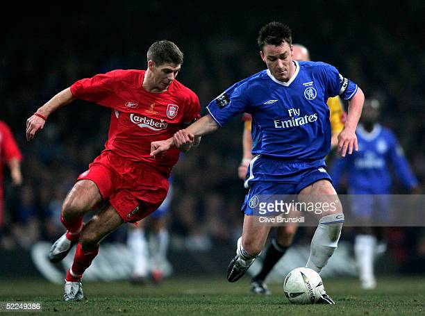 Steven Gerrard of Liverpool battles with John Terry of Chelsea during the Carling Cup Final match between Chelsea and Liverpool at the Millennium...