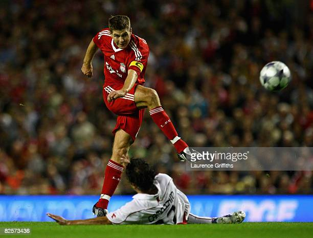 Steven Gerrard of Liverpool battles with Marcos Camozzato of Standard Liege during the UEFA Champions League Qualifier Third Round Second Leg Match...