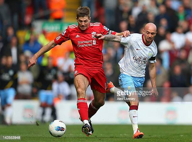 Steven Gerrard of Liverpool beats Stephen Ireland of Aston Villa during the Barclays Premier League match between Liverpool and Aston Villa at...