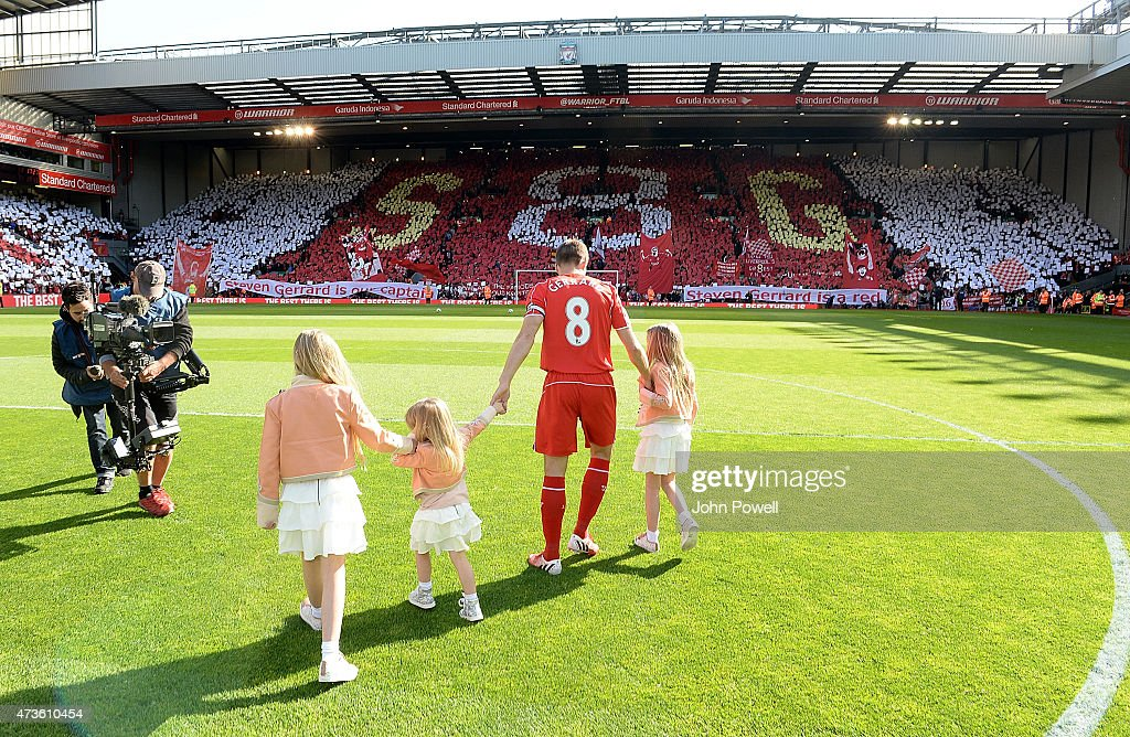 Steven Gerrard of Liverpool brings his daughters onto the pitch before the Barclays Premier League match between Liverpool and Crystal Palace at Anfield on May 16, 2015 in Liverpool, England.