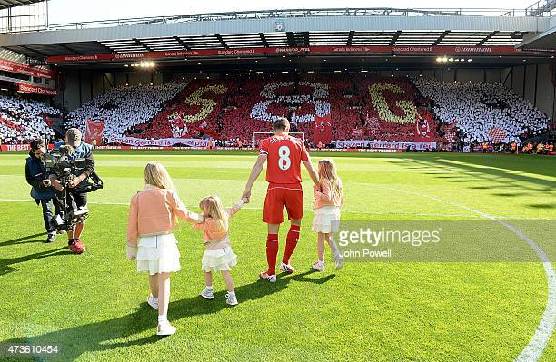 Steven Gerrard of Liverpool brings his daughters onto the pitch before the Barclays Premier League match between Liverpool and Crystal Palace at...
