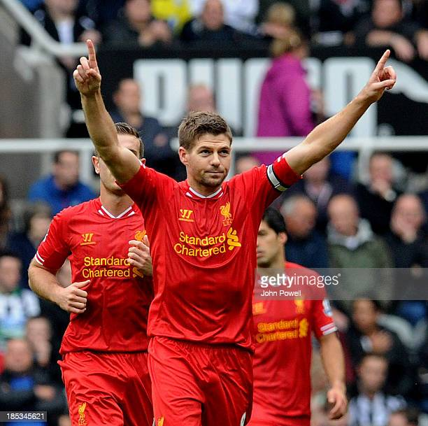 Steven Gerrard of Liverpool celebrates after scoring his 100th Premier League goal from the spot during the Barclays Premier League match between...