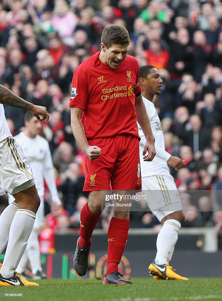 Steven Gerrard of Liverpool celebrates after scoring the first goal from the penalty spot during the Barclays Premier League match between Liverpool and Swansea City at Anfield on February 17, 2013 in Liverpool, England.