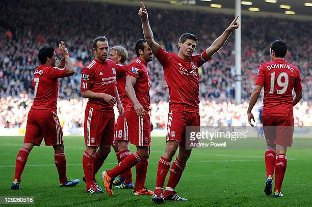 Steven Gerrard of Liverpool celebrates after scoring the opening goal during the Barclays Premier League match between Liverpool and Manchester...