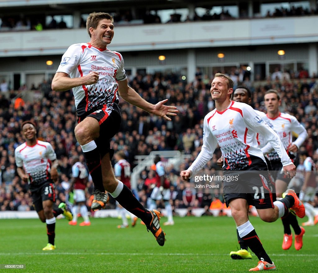 Steven Gerrard of Liverpool celebrates after scoring the second goal from the penalty spot during the Barclays Premier League match between West Ham United and Liverpool at Boleyn Ground on April 6, 2014 in London, England.