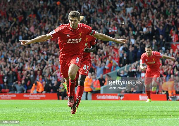 Steven Gerrard of Liverpool celebrates his goal during the Barclays Premier League match between Liverpool and Everton at Anfield on September 27...