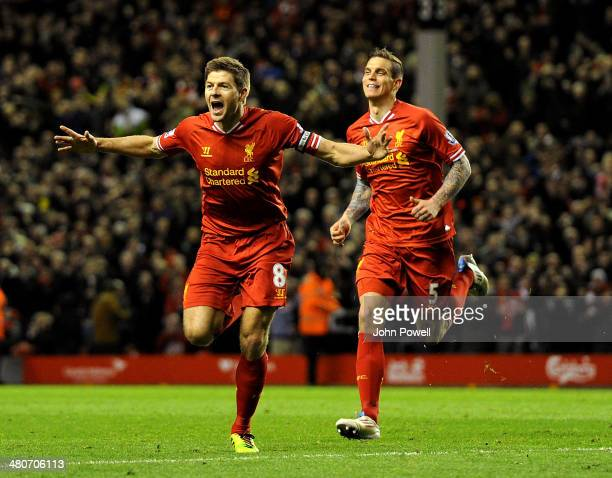 Steven Gerrard of Liverpool celebrates his goal with Jordan Henderson during the Barclays Premier Leauge match between Liverpool and Sunderland at...