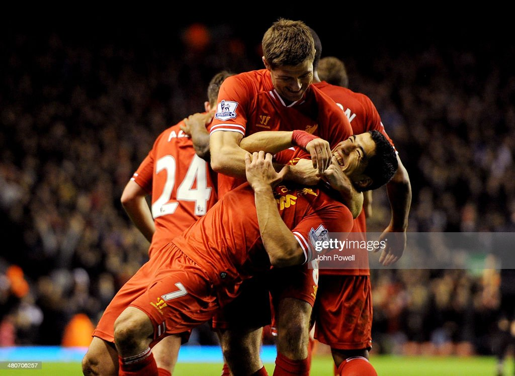 Steven Gerrard of Liverpool celebrates his goal with Luis Suarez during the Barclays Premier Leauge match between Liverpool and Sunderland at Anfield on March 26, 2014 in Liverpool, England.