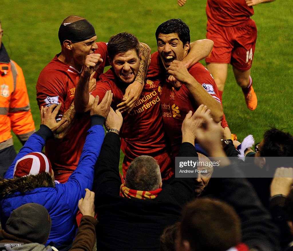 Steven Gerrard of Liverpool celebrates his goal with Martin Skrtel and Luis Suarez of Liverpool during the Barclays Premier League match between Liverpool and Everton at Anfield on January 28, 2014 in Liverpool, England.