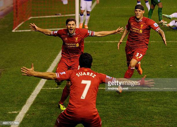 Steven Gerrard of Liverpool celebrates his goal with Martin Skrtel and Luis Suarez of Liverpool during the Barclays Premier League match between...