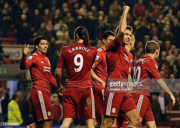 Steven Gerrard of Liverpool celebrates his third goal during the Barclays Premier League match between Liverpool and Everton at Anfield on March 13...