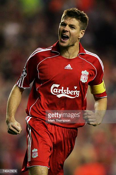 Steven Gerrard of Liverpool celebrates scoring his penalty in the shoot out during the UEFA Champions League semi final second leg match between...