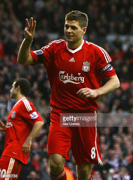 Steven Gerrard of Liverpool celebrates scoring his team's fifth goal to secure his hat trick during the Barclays Premier League match between...