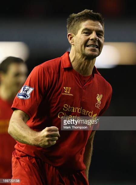 Steven Gerrard of Liverpool celebrates scoring his team's fourth goal during the Barclays Premier League match between Liverpool and Norwich City at...