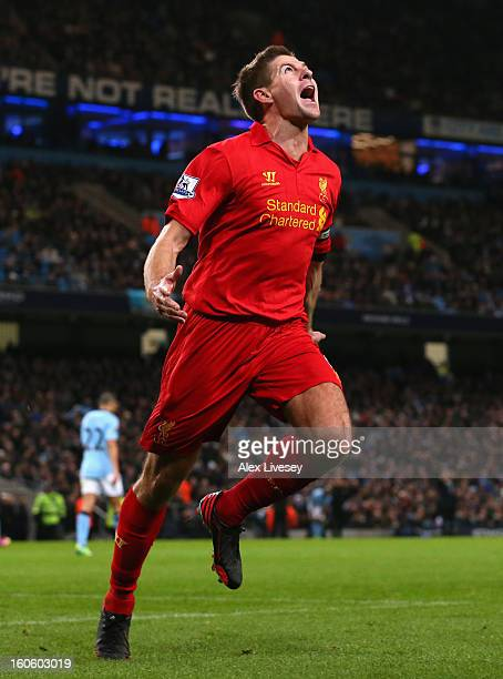 Steven Gerrard of Liverpool celebrates scoring his team's second goal during the Barclays Premier League match between Manchester City and Liverpool...