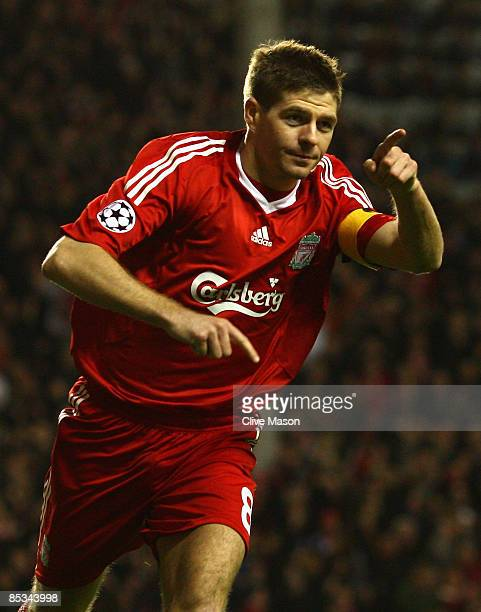 Steven Gerrard of Liverpool celebrates scoring his team's third goal during the UEFA Champions League Round of Sixteen Second Leg match between...