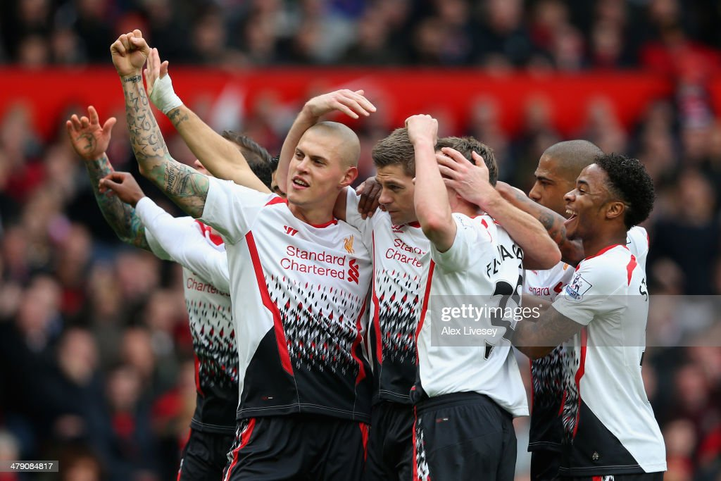 Steven Gerrard of Liverpool celebrates scoring the first goal with his team-mates during the Barclays Premier League match between Manchester United and Liverpool at Old Trafford on March 16, 2014 in Manchester, England.