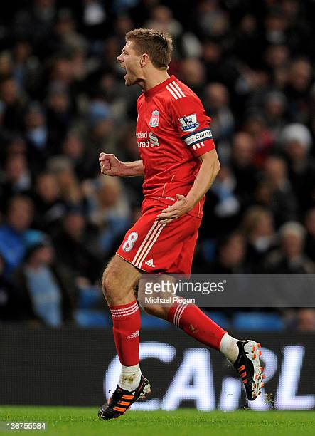 Steven Gerrard of Liverpool celebrates scoring the opening goal from a penalty kick during the Carling Cup Semi Final First Leg match between...